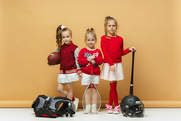Happy and beautyful children show different sport.