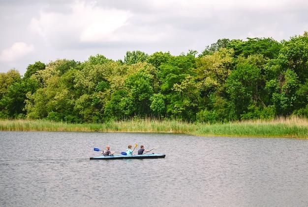 Happy best friends having fun on a kayaks