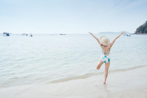 Happy bikini  woman  on the beach and clouds  sky.