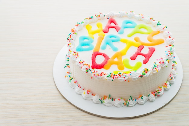 Happy birthday cake on wooden background