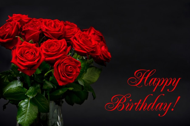 Happy birthday! card concept. red roses on black background. festive arrangement