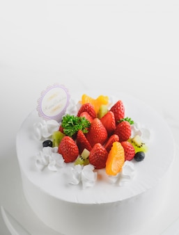 Happy birthday fresh fruit cake with chocolate happy birthday on cake concept with strawberry kiwi fruit cake.