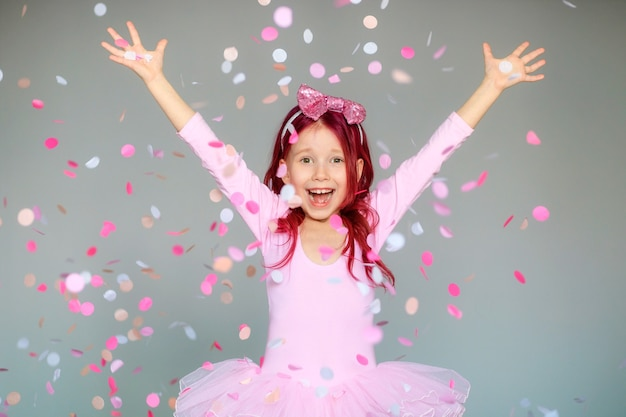 Happy birthday girl with confetti on gray background