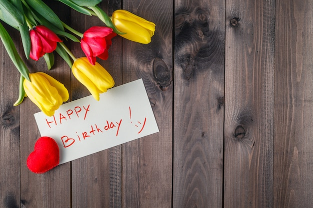 Happy birthday message and flowers
