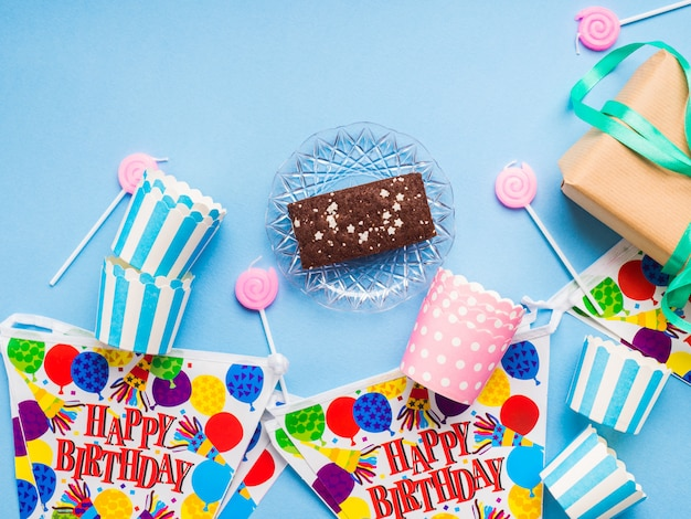 Happy birthday party items flat lay