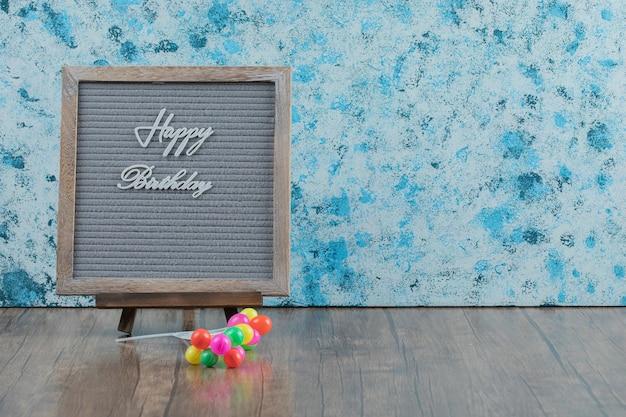 Happy birthday phrase embedded on grey background