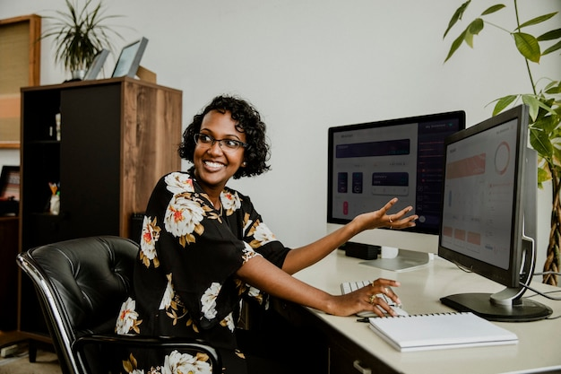 Happy black businesswoman working in the office