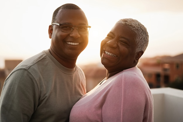Happy black couple having tender moment outdoors at summer sunset