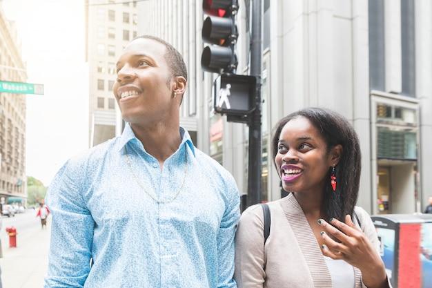 Happy black couple walking in chicago
