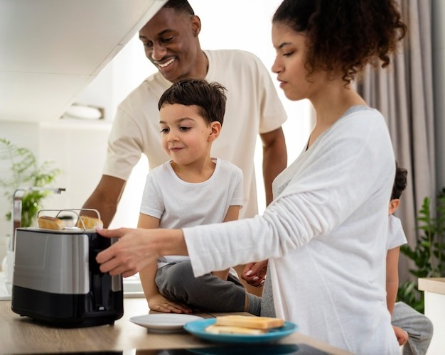 Happy black family preparing breakfast food