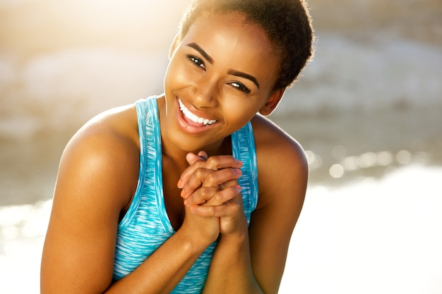 Happy black fitness woman laughing outside