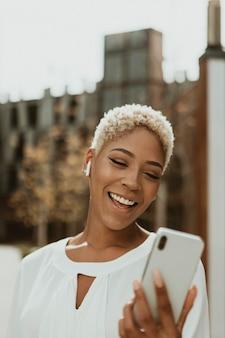 Happy black woman on her phone