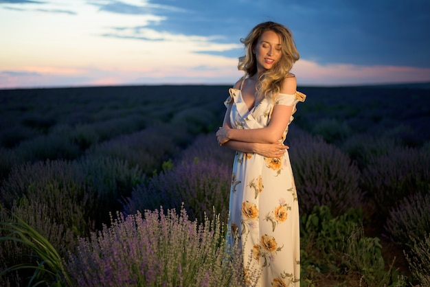Happy blonde woman in lavender field