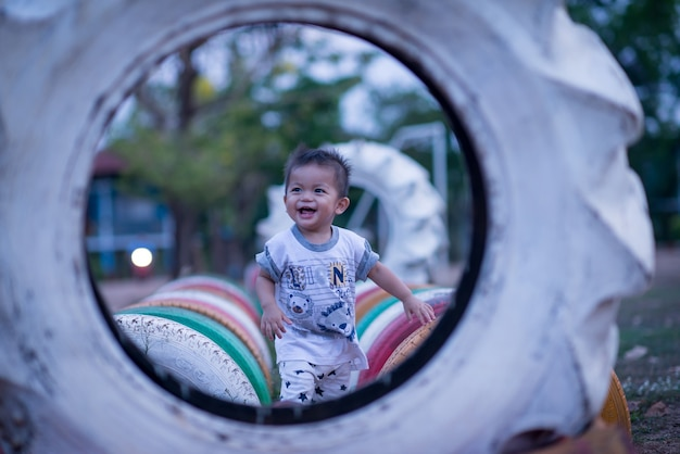 Happy boy child is smiling enjoying adopted life. portrait of young boy in park or outdoor