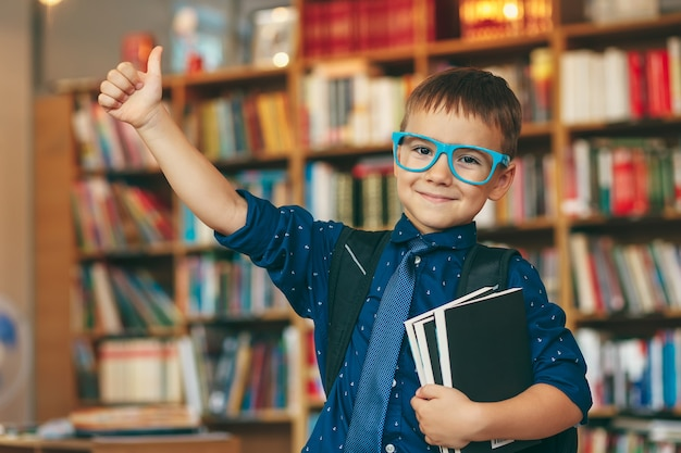Happy boy in library