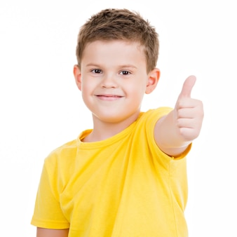 Happy boy showing thumbs up gesture.isoated on white