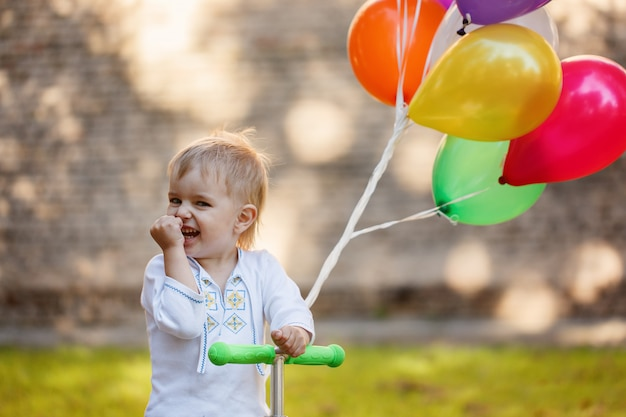 Happy boy with colorful balloon.