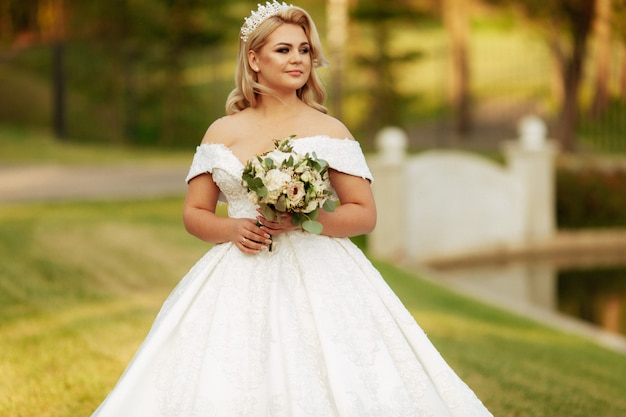 Happy bride on autumn forest