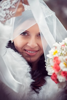 Happy bride in autumn park