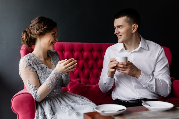 Happy bride and groom drink coffee and enjoy life