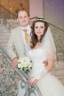 Happy bride and groom on ladder at wedding walk