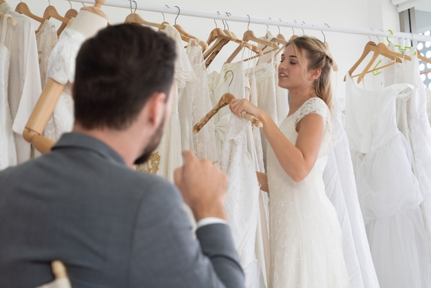 Happy bride and groom in wedding dress prepare for married in wedding ceremony. romantic  love of man and woman couple.