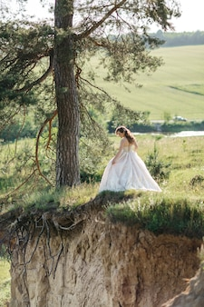 Happy bride walks in the woods