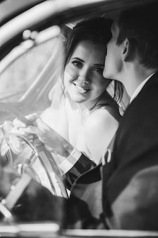 Happy bridegroom kisses his wife