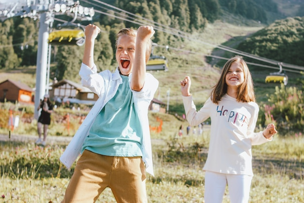 Happy brother and sister on mountain resort