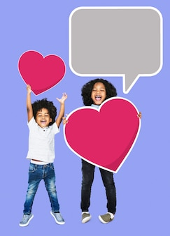 Happy brothers jumping with heart icons