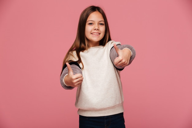 Happy brunette girl showing thumbs up and smiling