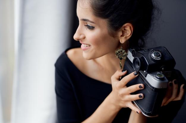 Happy brunette woman indoors photographer interior smile model