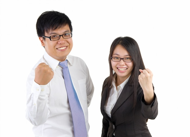 Happy business man and woman standing in office