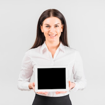 Happy business woman holding tablet with blank screen