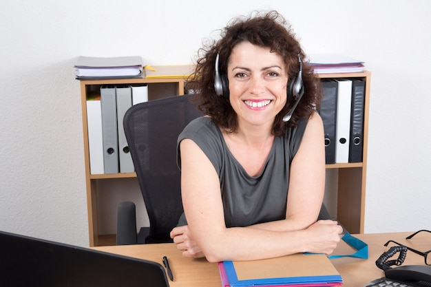 Happy business woman at the office smiling at call center