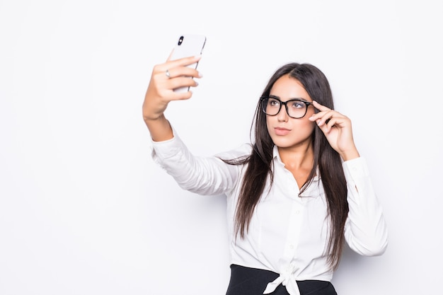 Happy business woman taking selfie photo on smartphone isolated on white