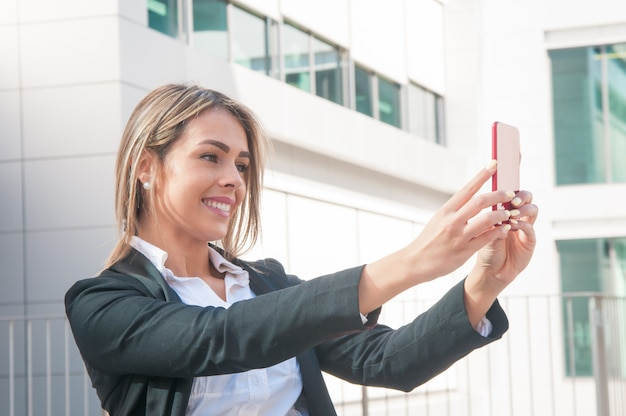 Happy business woman talking selfie photo outdoors