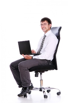 Happy businessman on chair with laptop