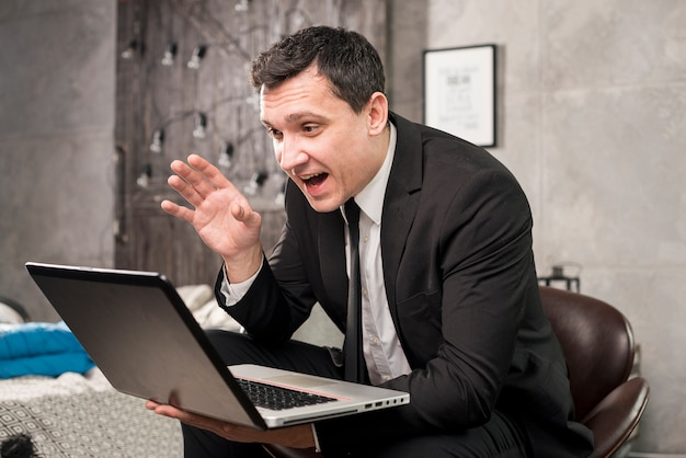 Happy businessman having video conference