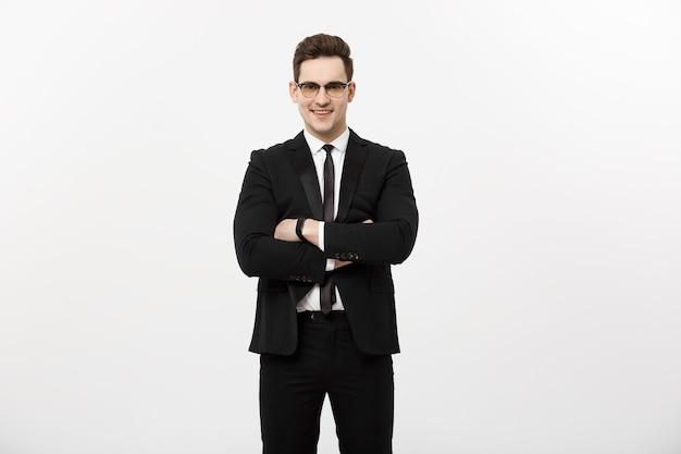 행복 한 사업가 절연-흰색 배경 위에 절연 교차 팔을 서 있는 성공적인 잘생긴 남자.