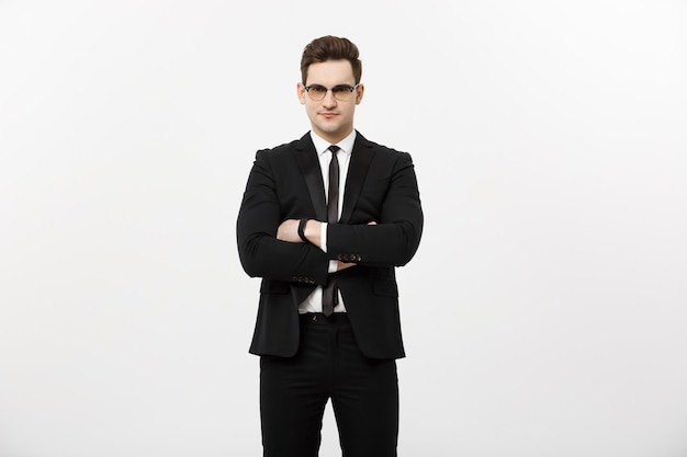 Happy businessman isolated - successful handsome man standing with crossed arms isolated over white background.