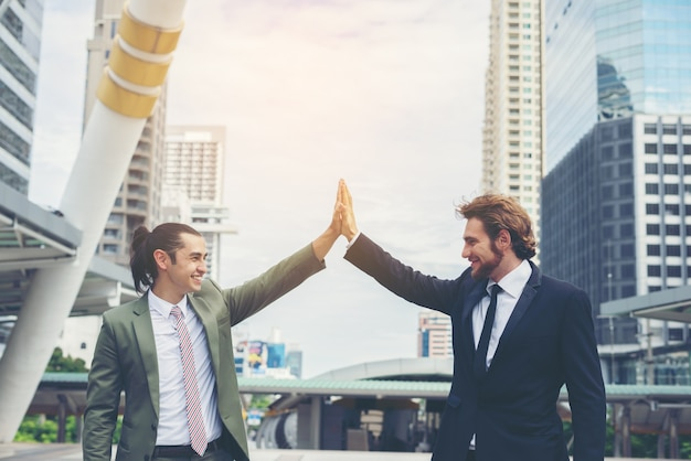 Happy businessman success with deal together. business success and goal concept