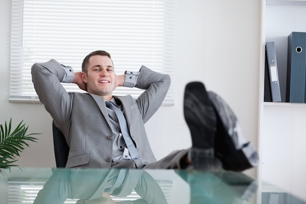 Happy businessman taking a rest