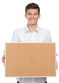 Happy businessman with corkboard