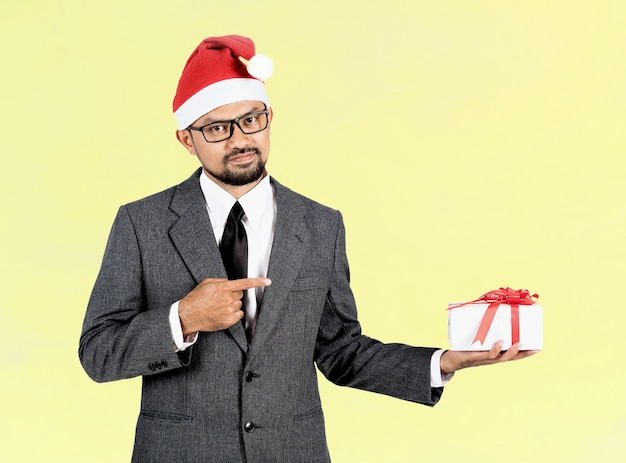 Happy businessman with gift