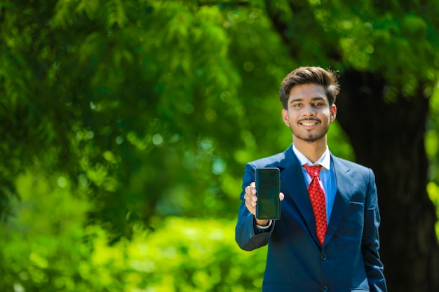 Happy businessman with smartphone
