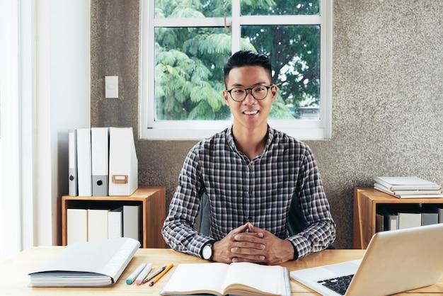 Happy businessman at work