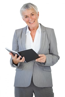 Happy businesswoman holding notepad
