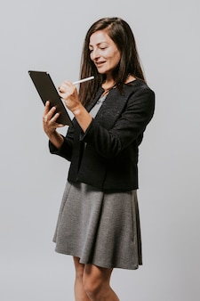 Happy businesswoman using a digital tablet
