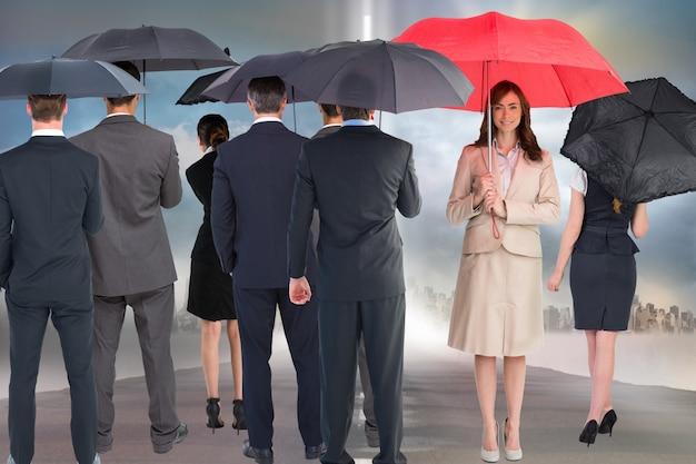 Happy businesswoman with red umbrella